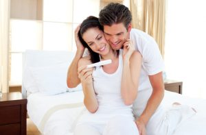 Enamoured couple finding out results of a pregnancy test