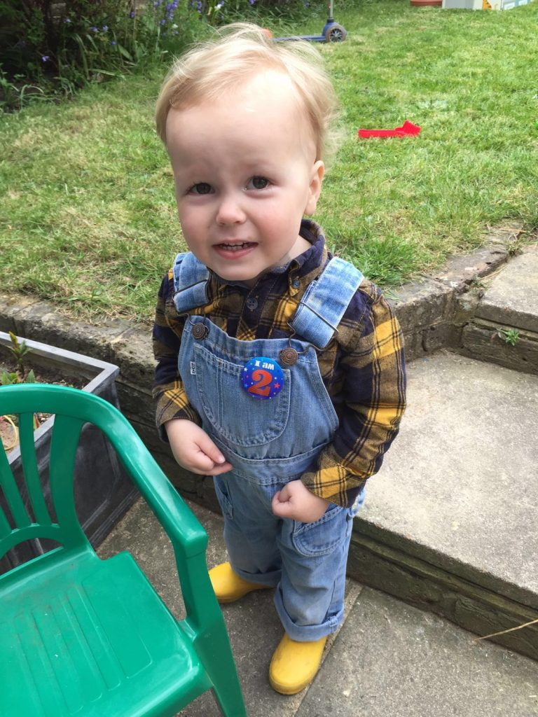 Alfie, boots on, ready to start digging